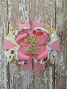 Pink and gold first birthday hair bow number by TheJMarieBoutique