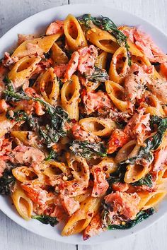 Salmon Pasta with Sun-Dried Tomato Cream Sauce and Spinach - quick and easy dinner made in 30 minutes! Pan-seared salmon is combined with the delicious penne in a flavorful, restaurant-quality cream sauce. Salmon is a Salmon Pasta Recipes, Creamy Salmon Pasta, Pasta Dinner Recipes, Fish Recipes, Seafood Recipes, Cooking Recipes, Healthy Recipes, Pasta With Salmon, Salmon Recipe Pan