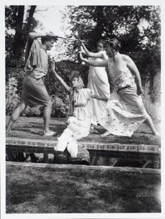 Julian, Quentin, and Angelica Bell performing a play about Damon and Phyllis with Janie Bussy in the garden of Charleston, owned by Vanessa Bell and Duncan Grant.
