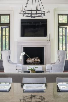 classic luxury home design new construction family room fireplace large chandelier kitchen island floor to ceiling windows washington dc