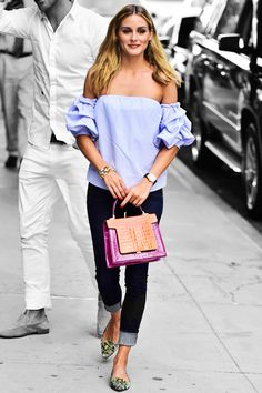 Olivia Palermo pairs an off-the-shoulder top with cuffed skinny jeans and a boxy bag. Her watch looks elegant — yet understated — and her flats are the perfect look for fall