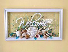 WELCOME To your vacation! Your on beach time! This is the perfect addition to anyones beach cottage to set the mood. This seashell art is set in a simple, white frame that measures approximately 12 x 22 in diameter. Each shell is bonded securely to the clear glass with a resin that gives the look Beach Cottage Decor, Coastal Decor, Beach House Bedroom, Blue Wall Decor, Beach Kitchens, Shell Collection, Seashell Art, Beach Signs, Glass Wall Art