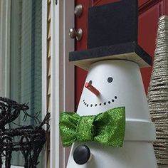 Make a Terra Cotta Snowman. Snowman, my favorite part of winter.  This dude is very cute and non-melting.  I consider him a CA snowman.