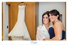 bride and bridesmaid getting ready at blessed sacrament church in warren ohio