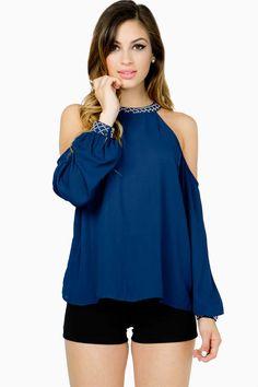 A gorgeous chiffon blouse with a subtle bead trimmed neckline and cold shoulders. Keyhole back. BOUTIQUE FIVE.