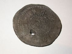 Cloth seal from Leiden in the Netherlands. It is stamped with the word 'Leyden' in black letter and the Arms of Leiden in the centre. Lead seals were attached to bales of cloth for quality control. They provide details about the fabric: brand name, size and source, as well as the maker's personal mark. This seal was attached to linens or cottons imported from Europe and indicates the important role London played in the international textile trade.  Production Date: Late Medieval; 15th…