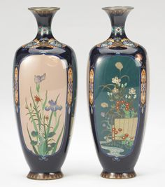 A pair of cloisonné enamel vases By Hayashi Yojiro, Meiji period Each of rounded rectangular section tapering to a flared foot, the sides decorated in silver wire and bright enamels with complimentary images of floral panels, all reserved on a mirror-black ground, two stylized floral band encircling the waisted neck, a ring of lappets at the foot, the base centered by a maker's mark 'Yo'