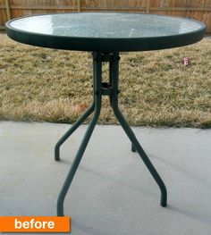 a plain glass and metal patio table