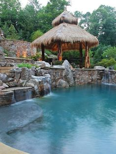 What can possibly be better than a swimming pool in your backyard landscape, a small pool waterfall to create that relaxing vibrant sound while you are enjoying your favorite beverage in a suspended outdoor bed or lounge chair? Swimming Pool Water, Swimming Pools Backyard, Swimming Pool Designs, Lap Pools, Indoor Pools, Pool Gazebo, Pergola, Tiki Hut, Kleiner Pool Design