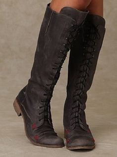 distressed black leather riding boot with touches of red inlay... fun!