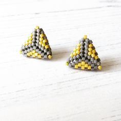 Hand-beaded stud earrings in super-summery colours! Triangle Earrings, Stud Earrings, Ancient Egyptian Artifacts, Resin Glue, Native American Beadwork, Beading Techniques, Pantone Color, Needle And Thread, Home Crafts