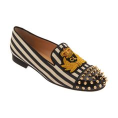 Christian Louboutin Round toe loafer covered in striped cotton with signature Louboutin insignia at vamp. Patent leather cap toe covered with gold-tone studs. Grosgrain trim and stacked 15mm heel.