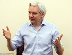 Sticking the knife in: Julian Assange has defended collating the Sony hack into one searchable database saying that the entertainment giant has links to the Democratic party and the American 'military industrial complex'