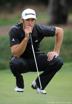 Dustin Johnson of USA looks at his putt