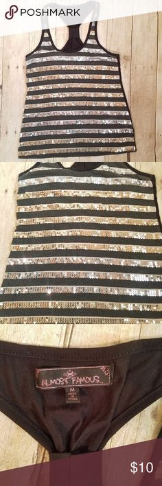 Sparkling Sequin Racerback Tank Top Silver Gold M Silver and gold sequins decorate the stripes in this black racerback tank. Perfect for New Year's Eve - or any other day that needs some sparkle! Size medium. No flaws seen, good pre-owned condition. Almost Famous Tops Tank Tops