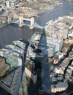 Renzo Piano's Shard building casts a shadow over London's Tower Bridge.