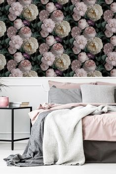 Oversized blooming florals climb this design with a romantic and elegant style; give your walls a touch of nature with this beautiful design. Seen here in the Charcoal colourway. See the complete collection now live on WallpaperDirect