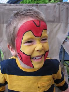 Hire a face painter for entertainment at your child's superhero birthday party!