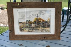 """I did this country scene in watercolor. This is framed in barnwood. Appx 20"""" x 40"""". $350."""