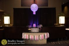 Bar with tassels and balloons at Lindsey's pink book themed Bat Mitzvah party at DoubleTree Bethesda | Pop Color Events | Adding a Pop of Color to Bar & Bat Mitzvahs in DC, MD & VA | Photo by Bradley Images