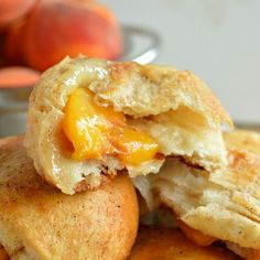 Peach Pie Biscuit Bombs - Sugar Dish Me. The only change I would make is to add a dash of whiskey to the peaches.