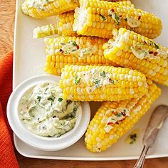 Slather boiled or grilled corn on the cob with a fresh, herbacious butter to make the vegetable irresistible.