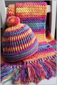 Rainbow Colourburst Scarf & Hat (separate links for each pattern)... link for the Scarf pattern: http://haakselsmadebymarion.blogspot.nl/2014/09/v-puff-scarf.html ... link for the Hat pattern: http://www.ravelry.com/patterns/library/zoes-special-ribbed-hat ... **only different in the hat is this photo shows a brim, instead of scalloped edge & pom pom**