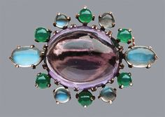A silver and gold cabochon brooch with amethyst, moonstone & chalcedony. British, c. 1910. Courtesy Tadema Gallery.