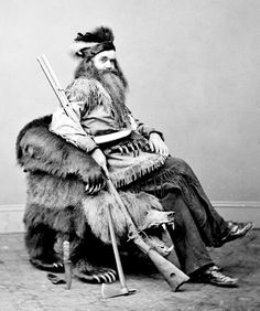 Seth Kinman one of the earliest settlers of California sitting on a chair he made out of a grizzly bear 1865