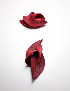Yong Joo Kim. Brooch: Transitions in Red XI, 2015. Hook-and-loop fastener, thread, sterling silver. Photo by: Studio Munch. 10 x 7 x 4 cm (top) and 7 x 17 x 4 cm.