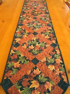 Rustic Leaves Autumn Table Runner, Quilted Patchwork, USA, Fall Quilted Table Runner. $59.95, via Etsy.