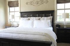 Just the bedding here.  Add some color to this bedding (pillows, etc), and this would be sweet!