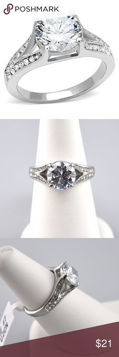 3.17 CT AAA CZ Stainless Steel Engagement Ring Featuring a 2.17 CT equivalent AAA round cubic zirconia center stone accented by an additional 28 round czs in a pave setting for a total carat weight of 3.17 for tons of eye catching sparkle. The band is stainless steel, making it hypoallergenic, easy to care for, and will not tarnish or turn your finger Green. Smoke free pet friendly home. Jennies Jewelry Chest Jewelry Rings