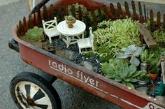 I have been debating about waht to do with a little wagon like this...now I think I know.