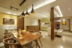 wood art house-dining- kitchen is designed in teak wood with the customized wooden door handle. the entry wall gives a luxury feel with teak wood giving it a modern contemporary look