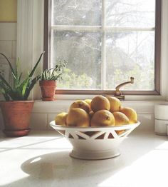 Display your market finds in this beautiful ivory fruit bowl, made by hand on a wheel. Inspired by cityscapes, each ceramic bowl is dipped in a satin glaze for a subtle gloss, making it a lovely centerpiece for your kitchen table.