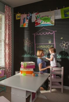 Kids Craft Room featuring a chalkboard accent wall for playing!