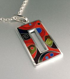 """I created this pendant design by forming fine silver wires on fine silver base. Cloisonné cells were inlayed with various transparent, opaque enamels and fired numerous times. At the end it was hand polished. The pendant measures 1 1/2""""long X 3/4 wide All items come in a beautiful gift box."""