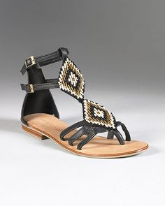 "#sandal  Aztec-inspired beading on this gladiator sandal turns a trendy style into a natural beauty. Looks perfect with leggings and a tunic. Details: Leather upper Diamond shaped patches covered in multi-color beads Ankle strap 1/4"" heel Rubber sole Imported"