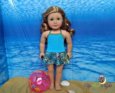 Blue leopard skirted bathing suit by upowlnighcrafting on Etsy. Made from the Wild Waves One-Piece Skirted Swimsuit pattern. Find it at https://www.pixiefaire.com/products/wild-waves-one-piece-skirted-swimsuit-18-doll-clothes-1. #pixiefaire #wildwavesskirtedonepieceswimsuit