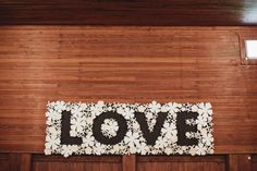 """""""LOVE"""" sign made of white paper flowers // photo by Sara & Rocky Luxe Wedding, Wedding Pins, Wedding Ideas, Wedding Signage, Wedding Reception Decorations, Wedding In Puerto Rico, White Paper Flowers, Lettering, Typography"""