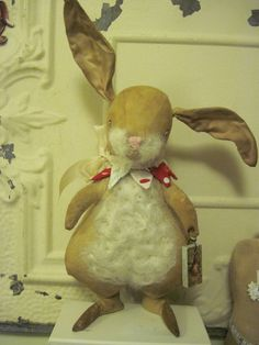 This little bunny stands 16 inches tall and has weighted feet to help it stand nicely. Its made out of osnaburg and has needle felting. So