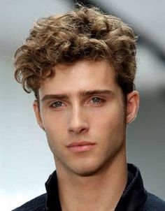 White curly men hair tend to pan the camera over the shock hair highlighting effect when playing a deep dark music sounds in the background