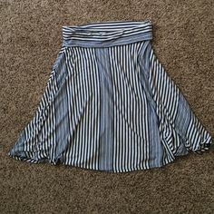 Small navy striped jersey skirt 95% rayon, 5% spandex navy and cream striped skirt. New with tags, never worn. Rolled waistband. Max Studio Skirts Midi
