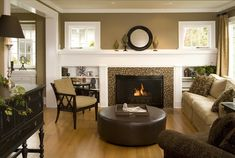 This Craftsman-style fireplace is very popular in 1920s and 1930s bungalows. This room has a modern approach that starts with the tile surrounding the fireplace. The rest of the room pulls from the deep browns and caramel colors found in the tile.