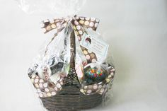 Ice Cream Gift Basket   - Sundae dishes  - Sundae sauces  - Williams Sonoma Ice Cream Starter  - Misc Sprinkles  - Chopped Nuts  - Maraschino cherries  - Gourmet cones or waffle bowls - ice cream scoop