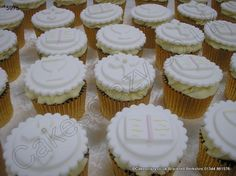 Communion Cross Chalis Bible Cupcakes. Selection of first holy communion cupcakes with sugar crosses chalice and a pray book sugar cutouts on triple layered icing topping a buttercream swirl