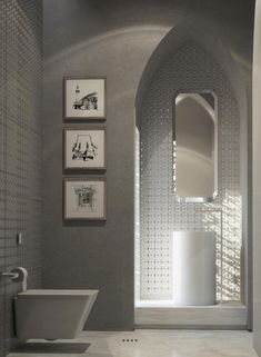 This decidedly modern bathroom uses the Moroccan style as a jumping off point for contemporary decor. The archway, for instance, is a classic example of the Moroccan look, but instead of using brightly colored tile mosaics, here we see flashy silver.