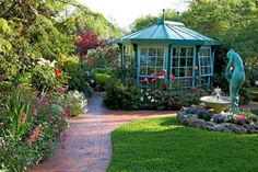 A conservatory and water feature add to the beauty of this spring garden.