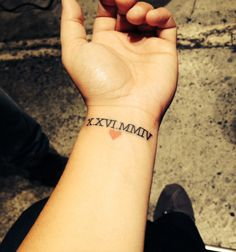 Roman numeral tattoo by Matt Lentz @ Under The Needle Tattoo in Seattle